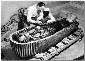 Howard Carter opens the innermost shrine of King Tutankhamen's tomb.